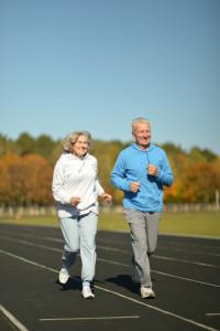 elderly couple running